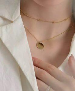 collar dos cadenas medalla oro